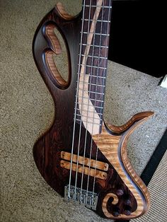 Benavente Guitars - five string bass guitar with scroll rounded edges and mixed woods - notice that lovely pickup area!