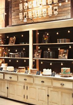 cake displayI love the dark background and the white marble counter & light cabinets & drawers.  Thinking I'll paint my backsplash dark (maybe chalkboard paint) & replace our formica countertops with light granite or marble.  Then do the same in our bar.