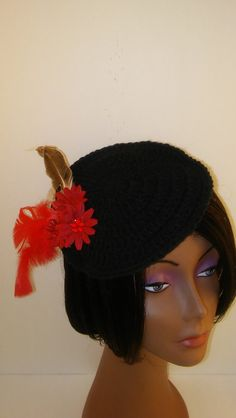 Crochet Fascinator Hat with feathers.  Crocheted in acrylic yarn, this hat is perfect for formal or informal events.  Wear it to church, parties, brunch or social gatherings.      This fascinator has a cardboard base and elastic to keep it on your head.  Hand wash.  Do not immerse in water, use a toothbrush to spot clean. | Shop this product here: http://spreesy.com/CreationsByLaya/75 | Shop all of our products at http://spreesy.com/CreationsByLaya    | Pinterest selling powered by…