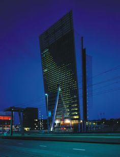 KPN Telecom Rotterdam The facade of the inclined side of the tower, a curtain-wall of 3,600 sq m, functions as a monochromatic 'electronic canvas', projecting animations which can be seen as far as 2km away, thanks to its grid of 896 specially manufactured, 24-volt lights.