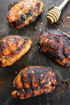 Sweet and Spicy Grilled Chicken Recipe on twopeasandtheirpod.com This easy grilled chicken recipe is a summer favorite!