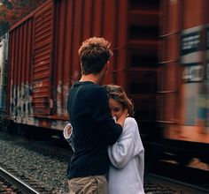 He pressed my face into his chest and held my body tightly to his own. As if afraid to let me go. Afraid I would try to jump in front of the train. But as the metal screeched on itself and the wind ripped at my jacket I knew I wouldn't. I was a coward, unwilling to live but afraid of death.