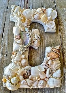 """Seashells on Monogram from the tropical place you went to on your honeymoon. Memories! Great decor -- Cute Idea to also """"outline"""" a picture frame....use things from the actual vacations!! Mod Podge Project"""