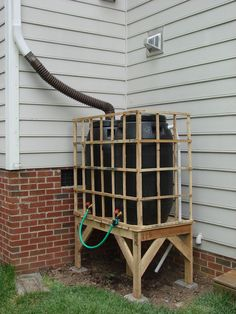 Pallet rain barrel stand for collecting rain water to use in your garden. Money saver!
