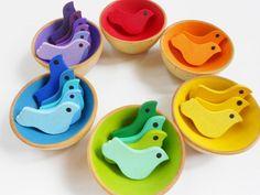 Handmade wooden rainbow bird sorting games at Laughing Crickets