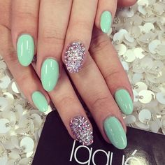 Mint Bedazzled Almond Nails! Come to Luxury Spa & Nails for all of your pampering needs! Call (803) 731-2122 or visit www.luxuryspaandnails.weebly.com for more information!