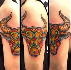Colorful bull's head on the shoulder.