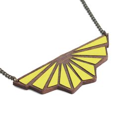 Lemon Toile de Fond Necklace: This quirky walnut art deco origami necklace has been hand painted in the perfect colour for this season, pale lemon yellow.  Surprisingly light weight, the necklace is based on original hand drawn illustration by Marta Chojnacka. It's been painted and finished by hand at her Barcelona workshop.    Made using natural solid walnut wood, for lasting finish a varnish coat has been applied by hand to each item.