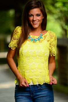 Summer fashion is all about fun and trust us, this lemon yellow top is a blast! The open lace design and deep scallop hems make for a breezy, trendy wear! This piece looks great with jeans, shorts, skirts...just mix and match until your heart's content!