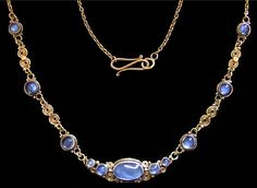 Dorrie Nossiter. An Arts and Crafts gold necklace set with moonstones, c. 1930. Size: Total length of necklace 44.5 cm. Central moonstone 1.3 cm wide. Fitted case. Sold by Van Den Bosch. View 3.