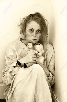 Woman In A Psychiatric Ward With Two Dolls. Stock Photo, Picture ...