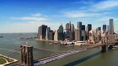 Stock Footage | Aerial view of Manhattan, Financial District and Brooklyn Bridge, NY,USA | Download using the VidLib app. 50.000 Royalty Free Clips'