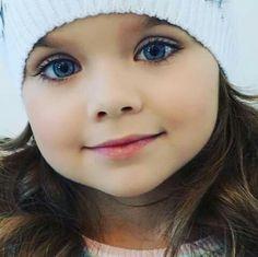 Beautiful baby girl with amazing deep blue eyes