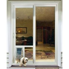 """""""IN THE GLASS""""   The Pet Door Guys System is a method of installing a dog door directly through the dual-pane glass of your sliding glass door! This is a neat idea and it's really essential when you must use your slider for the dog door and a patio pet panel won't leave enough room for you to go out. Sizes available are Small through X Large. #dogdoors"""