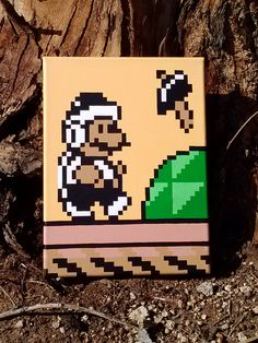 """Hammer Suit Mario from Super Mario Bros 3 for the Nintendo Entertainment System  Painted with Acrylics on a 9x12"""" Deep-Edge canvas, by nintentofu.  Sprites gathered from screen-capturing in-game various scenes within World-7, and composed after working on various betas to fit and work for canvas."""