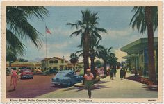 """Palm Canyon: This postcard, shows the downtown Palm Springs plaza, with Desmond's department store in the background. The store was open from 1947 until """"This is a beautiful place, but hot as Hades,"""" a tourist wrote on the back. American Mansions, Snoqualmie Falls, Yucca Valley, Coachella Valley, Vintage Postcards, Palm Springs, Walt Disney, Places To Go, Beautiful Places"""