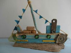 Driftwood boat and found objects. Sea side art design by Philippa komercharo.