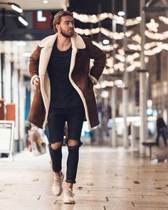 Make a brown shearling jacket and black destroyed jeans your outfit choice to create a great weekend-ready look. To break out of the mold a little, throw in a pair of beige running sneakers.   Shop this look on Lookastic: https://lookastic.com/men/looks/brown-shearling-jacket-black-crew-neck-t-shirt-black-jeans/23509   — Brown Shearling Jacket  — Black Crew-neck T-shirt  — Black Ripped Jeans  — Beige Athletic Shoes
