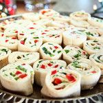 Christmas appetizer: Spread tortillas w/ softened cream cheese mixed w/ ranch dressing mix. Chop up red bell peppers and green onions and spread over. Roll up and refrigerate till ready to serve, then cut into rounds.