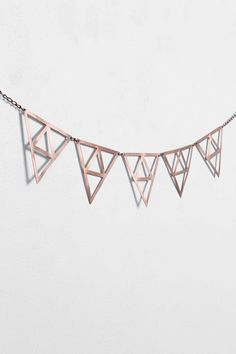 Project Nursery - Metal Triangle Wall Banner from Urban Outfitters in Rose Gold.