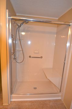 Acrylic showers and tubs stay white. No mold or discoloration like you would get with tile and grout. Looks better than tile, costs way less.