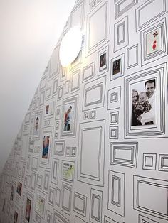 I have seen this wallpaper used in kids' rooms, but never in a stairwell gallery. BRILLIANT IDEA I MUST STEAL.