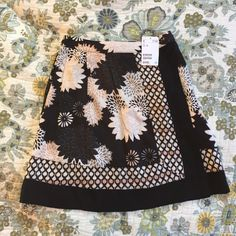 H&M skirt NWT H&M skirt. Black, grey, and pink faux wrap skirt. Super cute but too small for me. No trades. No PayPal. H&M Skirts Mini