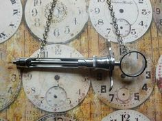 Real syringe necklace on silver chain by CuriologyStore on Etsy, £15.00