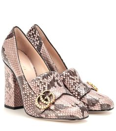 Gucci - Snakeskin leather loafer pumps - Gucci gives loafer pumps a retro update with fringed detailing and a tall block heel. The house's iconic logo in antique gold-tone metal is adorned with glossy faux pearls and contrasts beautifully with the pair's snakeskin leather. Style these with a wool miniskirt for a vintage-inspired luxe look. seen @ www.mytheresa.com
