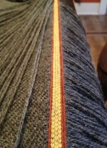 The tablet woven band showing correct tensioning of the beat to the cloth ends per inch.