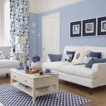 Beautiful Blue Living Room Decorating with Wooden Flooring with Rectangular Shaped Blue Carpet Floor and White Wooden Coffee Table using Drawers and Two White Fabric Sofas Design feat Pillows a part of  under Living Room