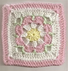 Free flower granny square pattern - this would be great for a baby blanket, especially if you alternated between this square design and a neutral colored, plain granny square [