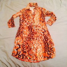 CAbi Shirt Dress Bright and fun shirt dress by CAbi. Worn once for a roast trip, because it looks very pretty but is as soft as pajamas. Collar and buttons down the breast. 3/4 sleeves like new. 96% rayon 4% spandex. CAbi Dresses