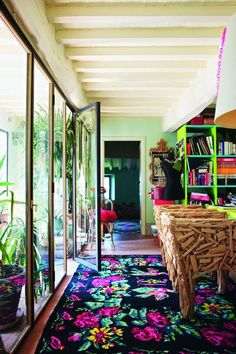 Vogue Living, Stephan Hamel's workroom, with floral Moldavian rugs and a pair of Campana brothers 'Favela' chair