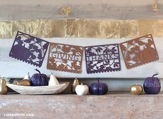 DIY Thanksgiving banner spelling out GIVING THANKS, to remind us all what the meaning of this upcoming holiday is really about. Free printable pattern.