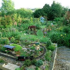 Now, what grandmother wouldn't be a hit with a train set in the garden / backyard? housetohome.co.uk
