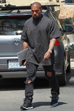 Kanye West wearing Faith Connexion Destroyed Allover Jumpsuit, Adidas Ultra Boost Shoes, Rolex Day-Date II President 41mm Watch