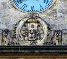 Legends of Sevilla: Shield of the city with El rey Fernando III with crown y sword, between Bishop Saints Isidore and Andrew with the NO∞DO emblem under the Town Hall clock