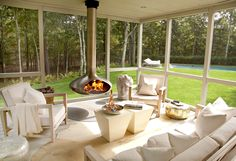 Paul Davis New York: Modern screened in porch with incredible ceiling mounted fireplace in stainless steel by ...