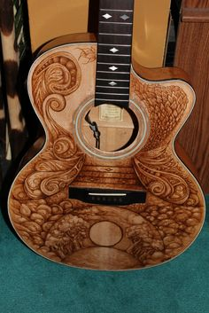 Here is the Martin guitar I've been working on. Had to strip down the finish so I could woodburn the pure wood grain. It was a long proc. Wood Burning Crafts, Wood Burning Patterns, Wood Burning Art, Wood Crafts, Guitar Art, Guitar Painting, Acoustic Guitar, Box Guitar, Guitar Picks