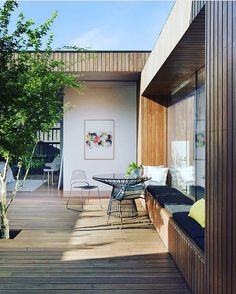 Outdoor space that feels like another living room with the use of Art and that extra long built in bench seat... Courtyard House by @mattgibsonad Styling @marshagolemac Photo @shannonmcgrath7