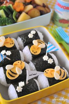 Bumble bee deko on very unique sushi rolls.