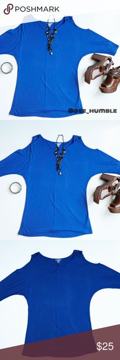 """CALVIN KLEIN Cold Shoulder Top Like NEW. Worn once.   Figure flattering. Sexy yet demure.  Beautiful blue cold shoulder top made of soft 100% brushed Rayon, subtly embellished with metal logo buttons at shoulders. Sleeves are dolman cut & fit me as 3/4 length...I'm short with short limbs.   APPROXIMATE FLAT MEASUREMENTS Sleeve 14 1/2"""" Shoulders Open Chest 18"""" Waist 16""""  Questions & reasonable offers welcome.   💲BUNDLE for best savings!💲👜👚👖👠📦📮😊💰 Calvin Klein Tops"""
