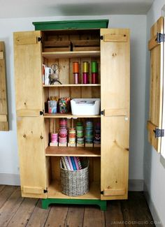 A DIY tutorial to build a tall cupboard with tons of concealed storage. An easy to build cabinet with moveable shelves and doors. #freeplans #storage