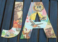 great idea: chipboard letters + vintage kids book pages + mod podge.