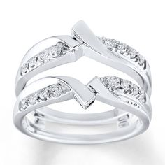 This lovely enhancer ring features lines of round diamonds complemented by twists of white gold above and below a space for her solitaire engagement ring, sold separately. The ring has a total diamond weight of carat. Engagement Ring Buying Guide, Best Engagement Rings, Engagement Ring Carats, Gold Wedding Jewelry, Gold Jewellery, Jewlery, Wedding Rings Simple, Platinum Jewelry, Bridal Rings