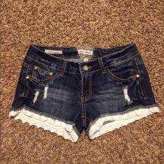 Denim Lace Shorts Super cute lace trimmed denim shorts! Worn a couple times. Hot Kiss Shorts Jean Shorts