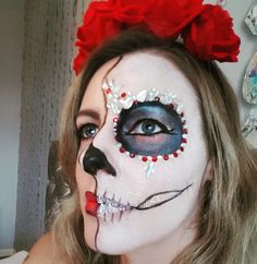 Day of the dead makeup. Sugar skull. Halloween. Half skull. Makeup with jewels