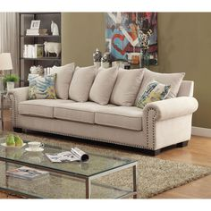 A sophisticated addition to any home, this chic sofa provides a comforting seating area with its multitude of pillows. Gorgeous nailhead trim adorns the rolled arms and showcase the structured framework beautifully.
