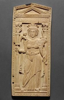 A fifth- to sixth-century ivory showing the personification of the city of Constantinople with symbolic attributes including a mural crown, a burning torch and a cornucopia, with a small representation of Amor, god of love, leaning against her shoulder. (Kunst Historisches Museum, Vienna)
